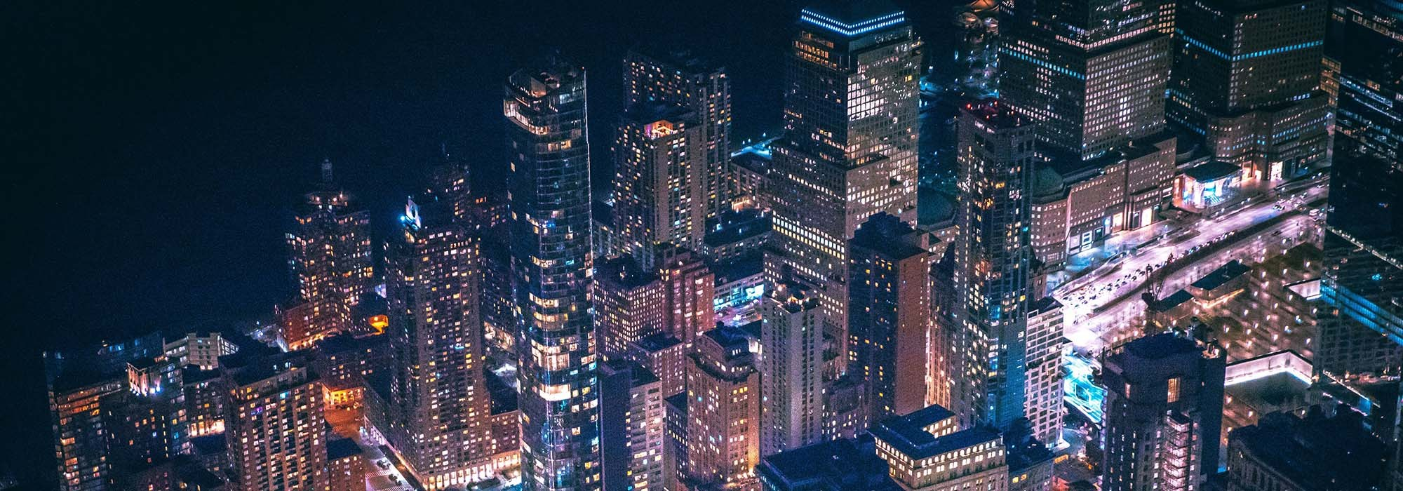 New York City Skyline at night with headlights & buildings lit up