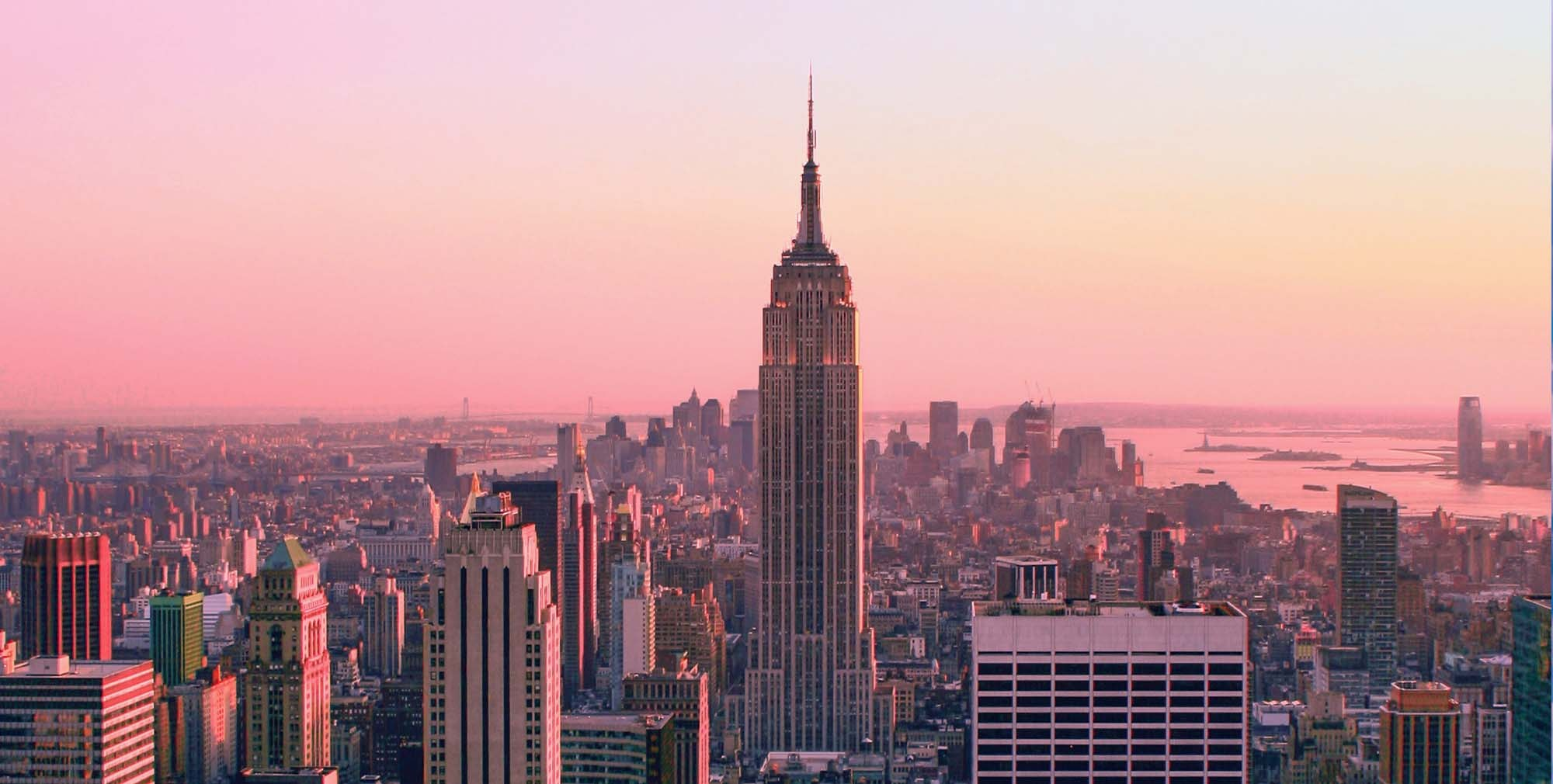New York City Skyline at sunset, centered on the Empire State Building facing south