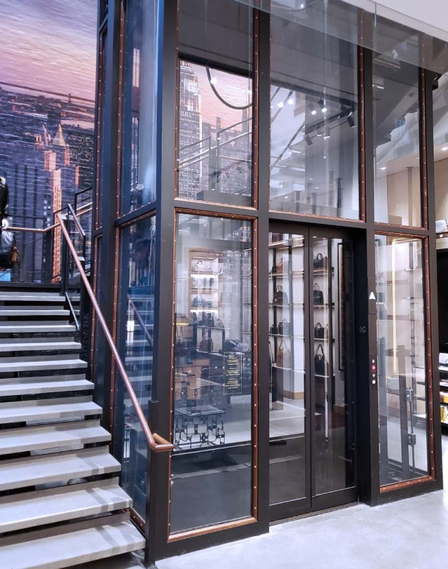 Coach integrated brand elements into their custom glass elevator