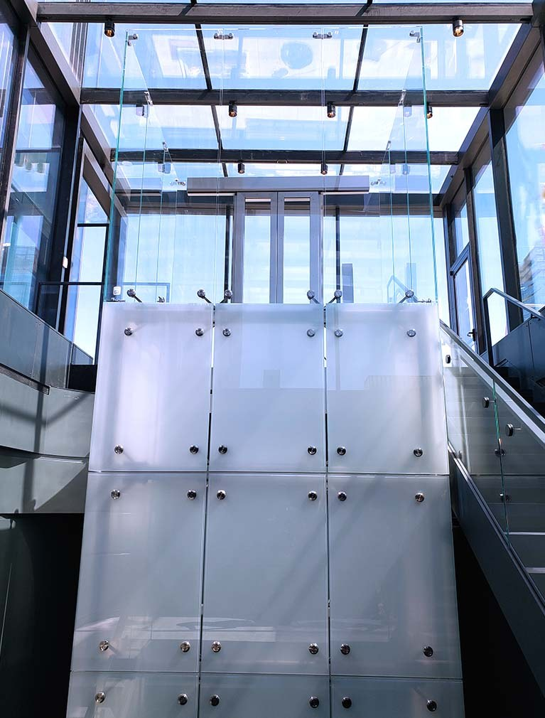 Clear Glass elevator landing in glass alcove