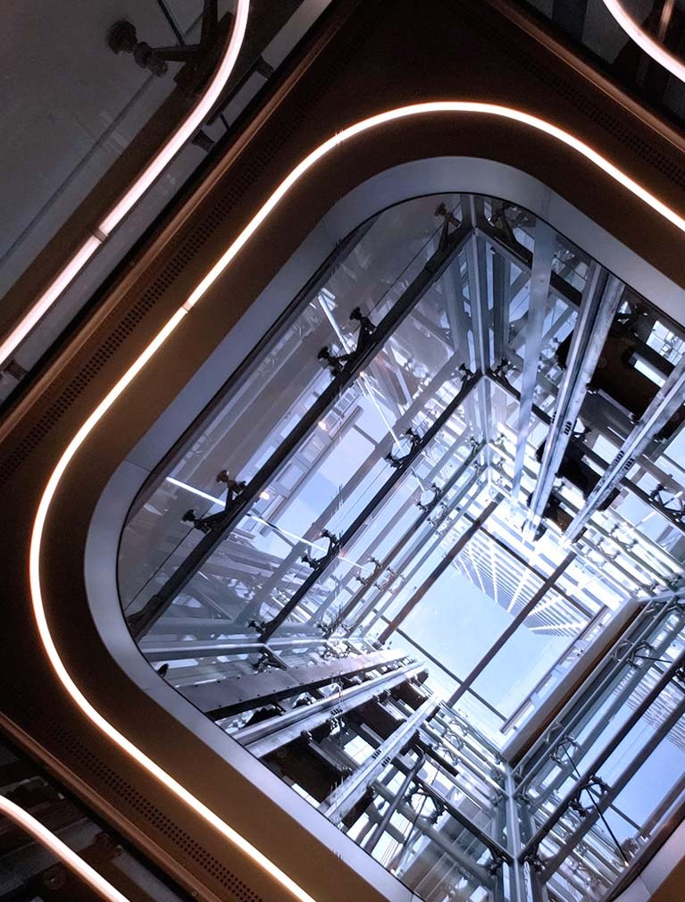 Custom Elevator design with glass hoistway, glass ceiling & glass elevator cab walls