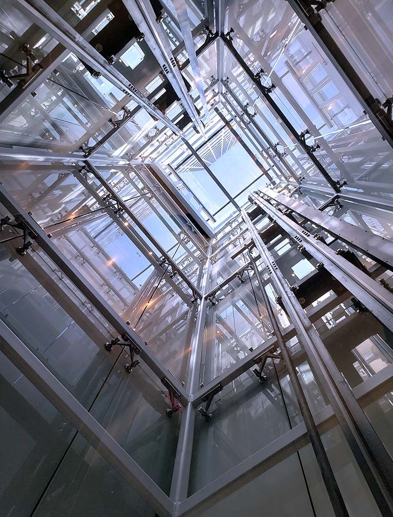 Glass Elevator shaft with 360 transparent view up