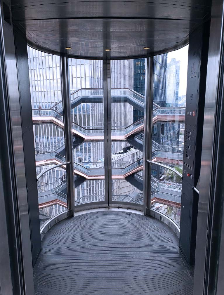 The Vessel at Hudson Yards Elevators internal view with glass walls and stainless steel cladding