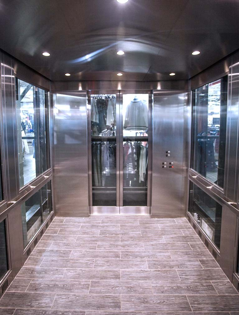 850 Third Ave, Brooklyn, glass elevator cab interior with stainless steel & glass paneled walls