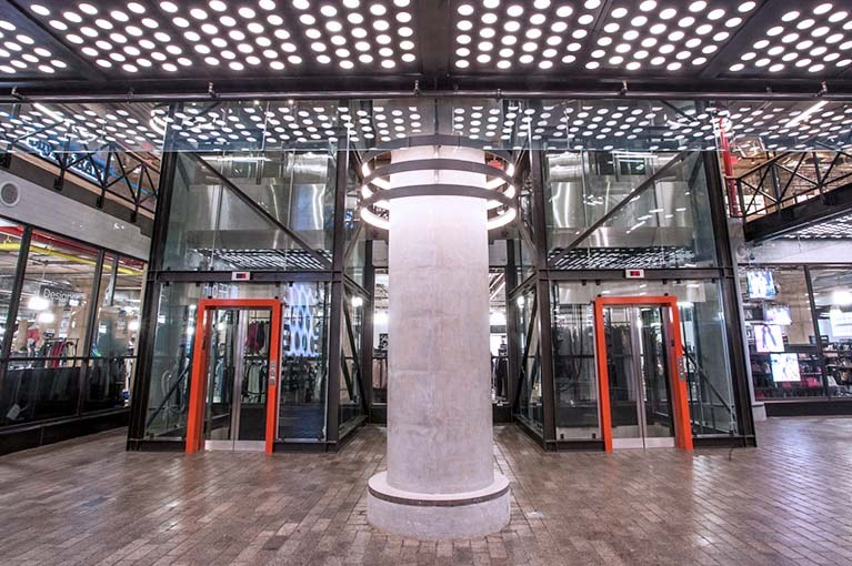850 Third Ave, Brooklyn, double elevator bay,straight on lobby, glass elevators with black steel girders & orange accent door frames