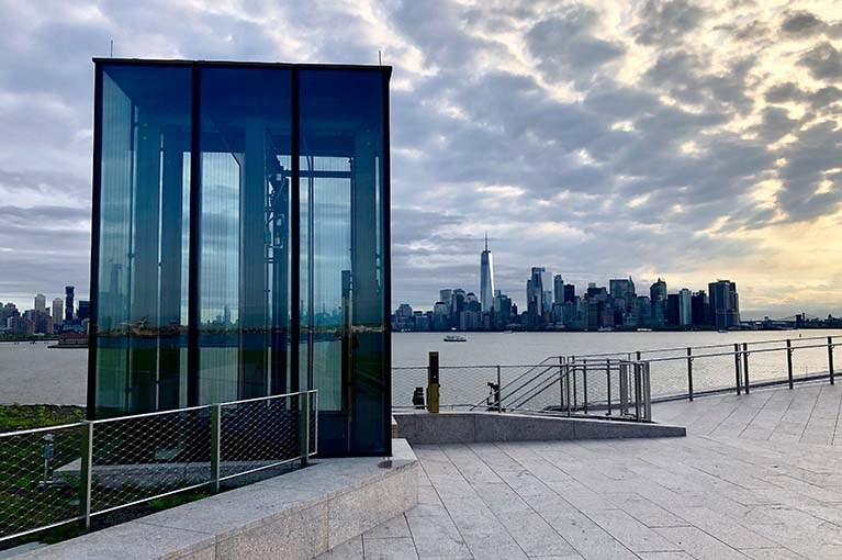 Liberty Island Museum Glass Elevator with the NYC skyline in the background