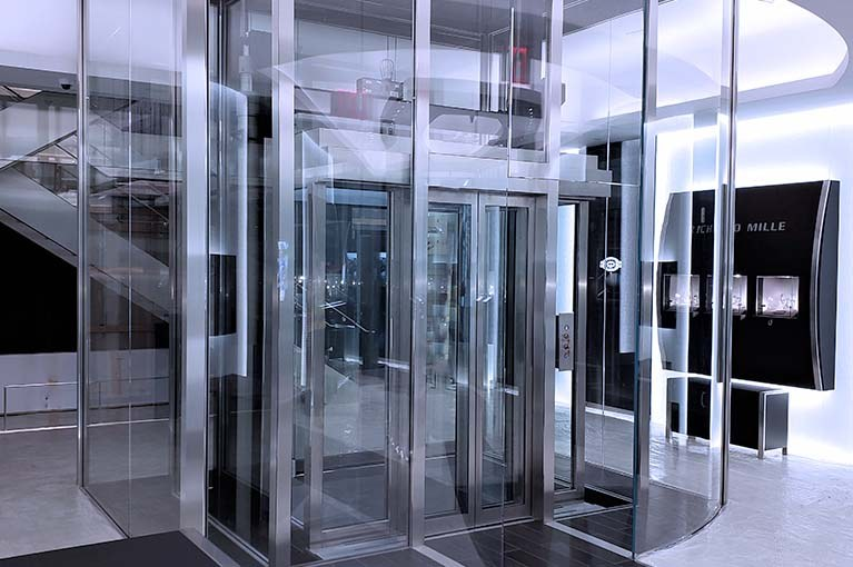 Custom Elevator design with watch bevel edges on stainless steel and glass elevator
