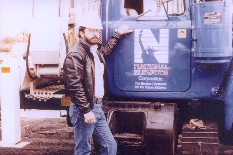 Statue of Liberty 1986 owner Douglas Muttart and his National Elevator truck