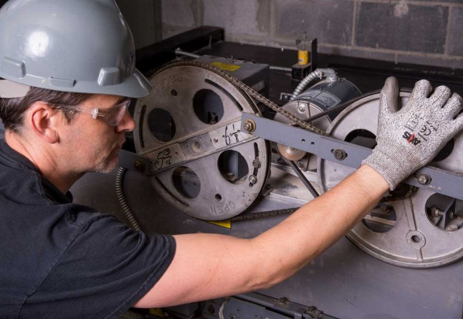 Maintenance Technician repairing elevator equipment