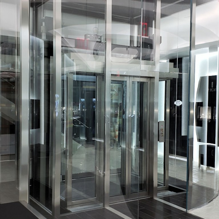 Custom glass elevator at Richard Mille, beveled steel and glass